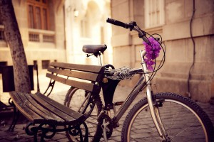 Beautiful urban bicycle secured on a bench.